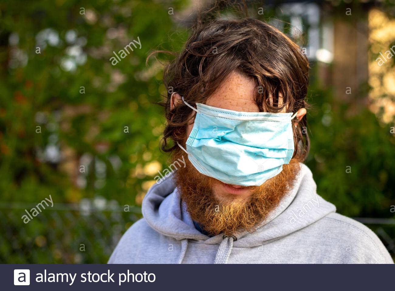 man-wearing-a-face-mask-over-his-eyes-and-nose-leaving-his-mouth-uncovered-2D4R17C.jpg